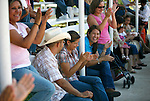 The crowd applauds for the completion of the Charreada in San Antonio, Texas on Sunday, August 3, 2008. Charreada, a Mexican rodeo, is a 400 year old Mexican tradition that combines ranch work sports with stylish outfits and traditions of generations of families. (Benjamin Sklar for ESPN the Magazine)