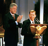 "President Vaclav Havel of the Czech Republic, right, appears during the live broadcast of the ""Millennium Evening Lecture Series"" as United States President Bill Clinton applauds on September 18, 1998..Credit: Ron Sachs / CNP"