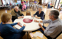 NWA Democrat-Gazette/DAVID GOTTSCHALK Regina Stuhle (from left), Harold Nelson, Emojene (cq) Hutchinson and her husband Dale play a game of Tic Monday, February 4, 2019, at the Farmington Senior Activity and Wellness Center. The Tic card game is a multi-player game that requires two decks of cards.
