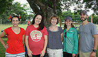 NWA Democrat-Gazette/CARIN SCHOPPMEYER Melissa Caffrey (from left), Katie Von Rembo, Theresa Rye, Jessica Farmer and Nick Booth help support Apple Seeds at Picnic on the Farm.