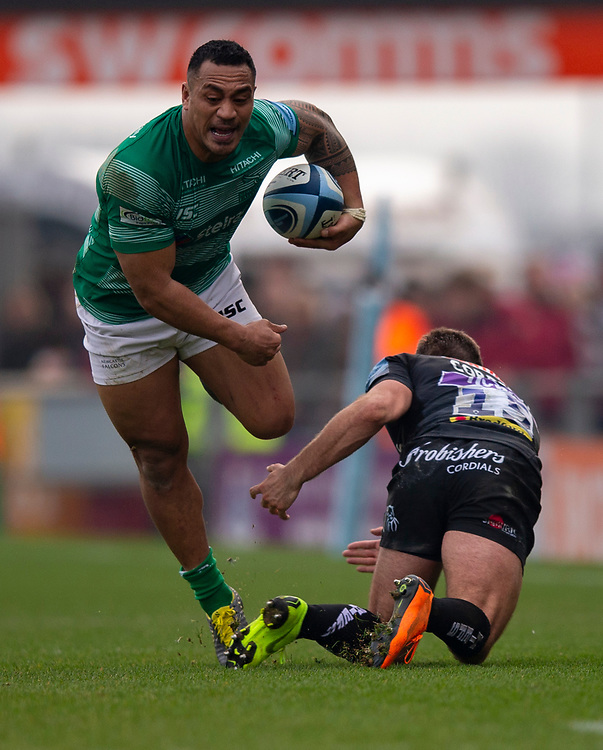 Newcastle Falcons' Sinoti Sinoti evades the tackle of Exeter Chiefs' Santiago Cordero<br /> <br /> Photographer Bob Bradford/CameraSport<br /> <br /> Gallagher Premiership - Exeter Chiefs v Newcastle Falcons - Saturday 23rd February 2019 - Sandy Park - Exeter<br /> <br /> World Copyright © 2019 CameraSport. All rights reserved. 43 Linden Ave. Countesthorpe. Leicester. England. LE8 5PG - Tel: +44 (0) 116 277 4147 - admin@camerasport.com - www.camerasport.com