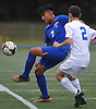 Juan Gonzalez #7 of Roosevelt, left, plays a ball under pressure from Ryan Huriwitz #2 of Roslyn during a Nassau County varsity boys soccer game at Roslyn High School on Thursday, Oct. 5, 2017. Trailing 2-1 in the second half, Gonzalez scored the tying and go-ahead goals in Roosevelt's 4-2 win.