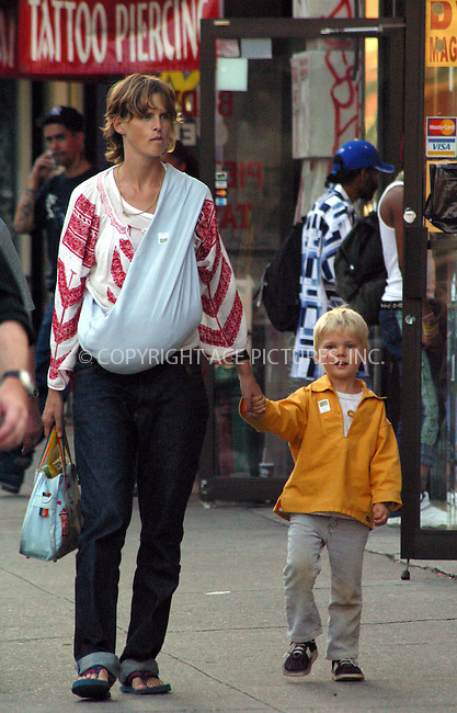 ***EXCLUSIVE***..British model Stella Tennant seen taking a stroll with her two children in West Village, New York. October 1, 2002. Please byline: Alecsey Boldeskul/NY Photo Press.   ..*PAY-PER-USE*      ....NY Photo Press:  ..phone (646) 267-6913;   ..e-mail: info@nyphotopress.com