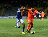 BOGOTA - COLOMBIA -27 -10-2015: Lewis Ochoa (Izq.) jugador de Millonarios disputa el balón con Daniel Londoño (Der.) jugador de Envigado FC, durante partido entre Millonarios y Jaguares FC, por la fecha 17 de la Liga Aguila II-2015, jugado en el estadio Nemesio Camacho El Campin de la ciudad de Bogota. / Lewis Ochoa (L) player of Millonarios vies for the ball with Daniel Londoño (R) player of Envigado FC, during a match between Millonarios and Jaguares FC, for the date 17 of the Liga Aguila II-2015 at the Nemesio Camacho El Campin Stadium in Bogota city. Photo: VizzorImage / Luis Ramirez / Staff.