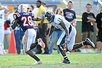 30 October 2010:  FIU cornerback Ashlyn Parker (11) pursues Florida Atlantic running back Willie Floyd (28) in the second quarter as the Florida Atlantic University Owls defeated the FIU Golden Panthers, 21-9, at Lockhart Stadium in Fort Lauderdale, Florida.