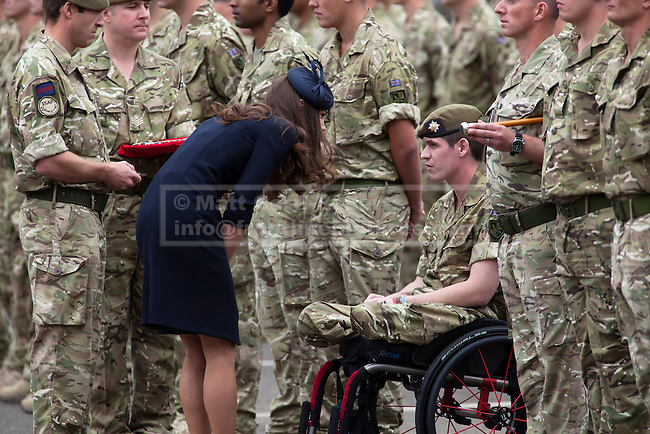 WINDSOR, UK  25/06/11. Double amputee Lance Corporal Scott Yarrington, who lost both of his legs during his units recent tour of Afghanistan, talks to the Duchess of Cambridge during a medals parade. The First Battalion, The Irish Guards, recently returned from operation Herric in Afghanistan, parade at their current base, Victoria Barracks, in Windsor to receive the Afghanistan Campaign Medal from the Duke and Duchess of Cambridge. Photo credit should read Matt Cetti-Roberts