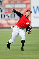 Center fielder Trayce Thompson #24 of the Kannapolis Intimidators makes a throw during fielding practice at Fieldcrest Cannon Stadium May 12, 2010, in Kannapolis, North Carolina.  Photo by Brian Westerholt / Four Seam Images