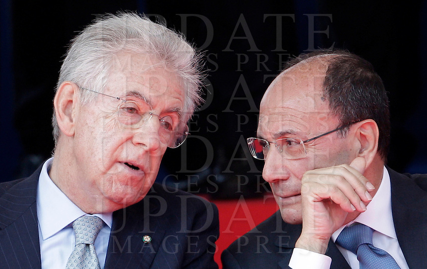 Il Presidente del Consiglio Mario Monti, a sinistra, parla al Presidente del Senato Renato Schifani durante la parata militare in occasione del 66esimo anniversario della proclamazione della Repubblica Italiana, ai Fori Imperiali, Roma, 2 giugno 2012..Italian Premier Mario Monti, left, talks to Senate President Renato Schifani during the military parade in occasion of the Italian Republic Day, in Rome, 2 june 2012..UPDATE IMAGES PRESS/Riccardo De Luca