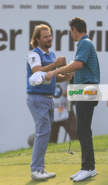 Victor Dubuisson (FRA) and Justin Rose (ENG) on the 18th green during Round 4 of the BMW Masters at Lake Malaren Golf Club in Boshan, Shanghai, China on Sunday 15/11/15.<br /> Picture: Golffile | Thos Caffrey<br /> <br /> All photo usage must carry mandatory copyright credit (&copy; Golffile | Thos Caffrey)