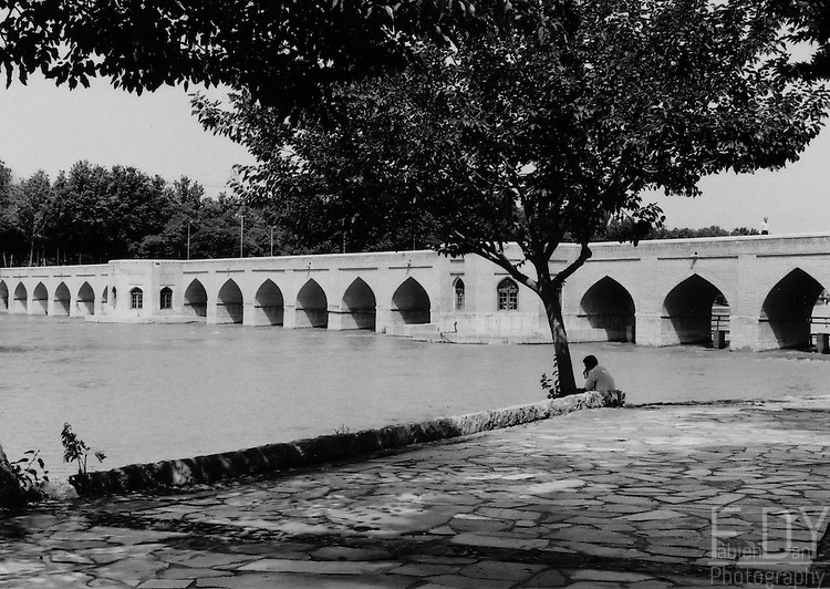 Old man along the zayandeh rud,overlooking one of the numerous bridge crossing Ispahan, the safavid capital