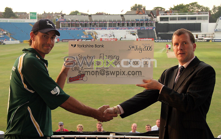 PICTURE BY VAUGHN RIDLEY/SWPIX.COM -  Cricket - Twenty20 Cup - Yorkshire v Nottinghamshire - Headingley, Leeds, England - 05/07/06...? Simon Wilkinson - 07811 267706...Yorkshire's Stuart Reagan presents Nottinghamshire's Stephen Fleming with the man of the match award.