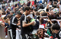 Wednesday, 23 April 2014<br /> Pictured: Chico Flores signing autographs for supporters.<br /> Re: Swansea City FC are holding an open training session for their supporters at the Liberty Stadium, south Wales,