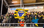 Stockholm 2014-12-19 Bandy Elitserien Hammarby IF - Broberg S&ouml;derhamn :  <br /> Broberg S&ouml;derhamns supportrar med en flagga efter matchen mellan Hammarby IF och Broberg S&ouml;derhamn <br /> (Foto: Kenta J&ouml;nsson) Nyckelord:  Elitserien Bandy Zinkensdamms IP Zinkensdamm Zinken Hammarby Bajen HIF Broberg S&ouml;derhamn supporter fans publik supporters jubel gl&auml;dje lycka glad happy