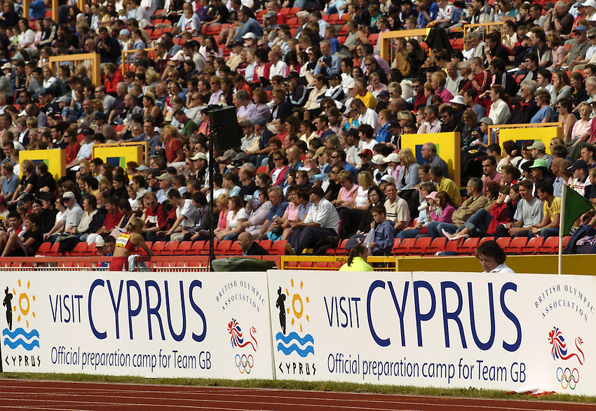 Photo. Jed Wee..Norwich Union British Grand Prix, 27/06/2004..Cyprus Tourism boards with crowd in background.