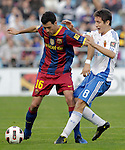 FC Barcelona's Sergio Busquets (l) and Real Zaragoza's Ander Herrera during La Liga match.October 23,2010. (ALTERPHOTOS/Acero)