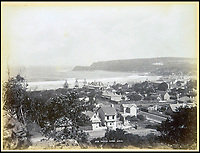 BNPS.co.uk (01202 558833)<br /> Pic: Nosb&uuml;sch&amp;Stucke/BNPS<br /> <br /> Manly, New South Wales.<br /> <br /> A stunning collection of photographs of Sydney decades before the iconic harbour bridge and opera house were built has been unearthed after 129 years.<br /> <br /> The black and white photo album captures the bustling city centre, picturesque main harbour and famous beaches of the future tourist hot-spot. <br /> <br /> The photos were taken by celebrated Australian photographer Henry King in 1888 who was born in England but emigrated to Australia at a young age and spent the rest of his life there.<br /> <br /> More recently they have fallen into the hands of a German collector who has decided to put them on the market and they are tipped to sell for &pound;1,800.<br /> <br /> Many of Sydney's most recognisable landmarks including Manly beach and Coogee bay look very different to what backpackers would encounter today.<br /> <br /> King also took various photos of Circular Quay - the city's main harbour - but missing from them are images of the Sydney Harbour Bridge and Sydney Opera House as these landmarks were both not built until well into the 20th century.