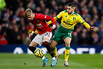 Brandon Williams of Manchester United and Emi Buendia of Norwich City battle for the ball during the Premier League match at Old Trafford, Manchester. Picture date: 11th January 2020. Picture credit should read: James Wilson/Sportimage
