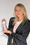 "Maria Sharapova holds up a bottle of Evian during the Evian ""Live Young"" photo shoot event she hosted at Openhouse Gallery on August 24, 2010."