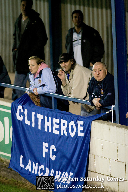 16.09.2008 Leek, England. A small group of Clitheroe fans watching their team's match against Leek Town in an FA Cup 1st Qualifying Round replay at Harrison Park, Leek. The first match ended in a one-all draw but it was Clitheroe who progressed to the next round winning the replay one-nil, despite having a man sent off in the second half. The preliminary stages of the FA Cup were used to determine which non-League clubs were included in the first round proper of the FA Cup. Photo by Colin McPherson.