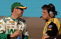 Nov 12, 2005; Phoenix, Ariz, USA;  Nascar Nextel Cup driver Matt Kenseth driver of the #17 Dewalt Tools Ford talks with his crew chief Robbie Reiser during qualifying for the Checker Auto Parts 500 at Phoenix International Raceway. Mandatory Credit: Photo By Mark J. Rebilas