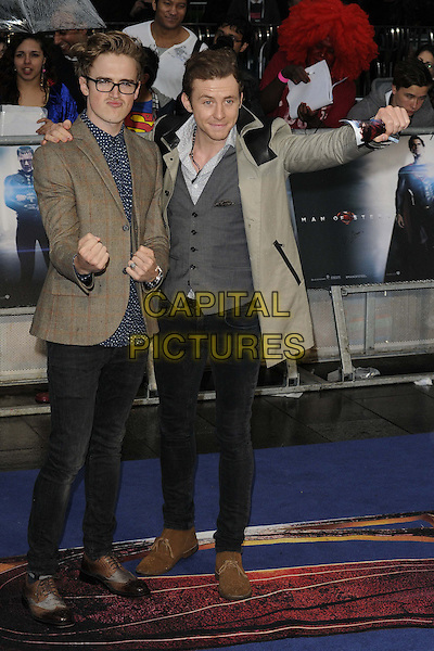 Tom Fletcher &amp; Danny Jones of McFly<br /> 'Man Of Steel' UK film premiere, Empire cinema, Leicester Square, London, England.<br /> 12th June 2013<br /> full length brown grey gray suit jacket waistcoat hand arm on over shoulder black jeans denim fists in air<br /> CAP/CAN<br /> &copy;Can Nguyen/Capital Pictures
