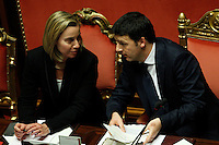 Il Presidente del Consiglio Matteo Renzi parla al Ministro degli Esteri Federica Mogherini, sinistra, in occasione del voto di fiducia sul suo governo, Roma, 24 febbraio 2014.<br /> Italian Premier Matteo Renzi talks to Foreign Minister Federica Mogherini, left, on the occasion of the confidence vote on his newly born government at the Senate, Rome, 24 February 2014.<br /> UPDATE IMAGES PRESS/Riccardo De Luca