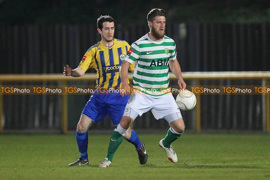 Scott Truman of Romford and Michael Power of VCD - Romford vs VCD Athletic - Ryman League Division One North Football at Ship Lane, Thurrock FC - 19/03/14 - MANDATORY CREDIT: Gavin Ellis/TGSPHOTO - Self billing applies where appropriate - 0845 094 6026 - contact@tgsphoto.co.uk - NO UNPAID USE