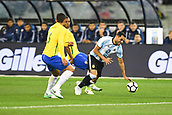 June 9th 2017, Melbourne Cricket Ground, Melbourne, Australia; International Football Friendly; Brazil versus Argentina; Gabriel Mercado of Argentina falls over the ball as he looks to go past the defenders