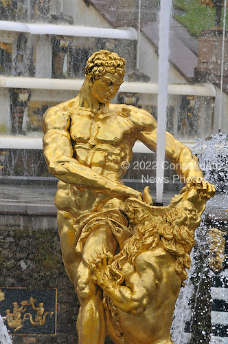 Peterhof, Russia - August 14, 2009 -- Close-up of one of the golden statues comprising one of the fountains at Peterhof, near St. Petersburg, Russia on Friday, August 14, 2009.  It was founded in 1710 as a summer residence for Peter the Great..Credit: Ron Sachs / CNP