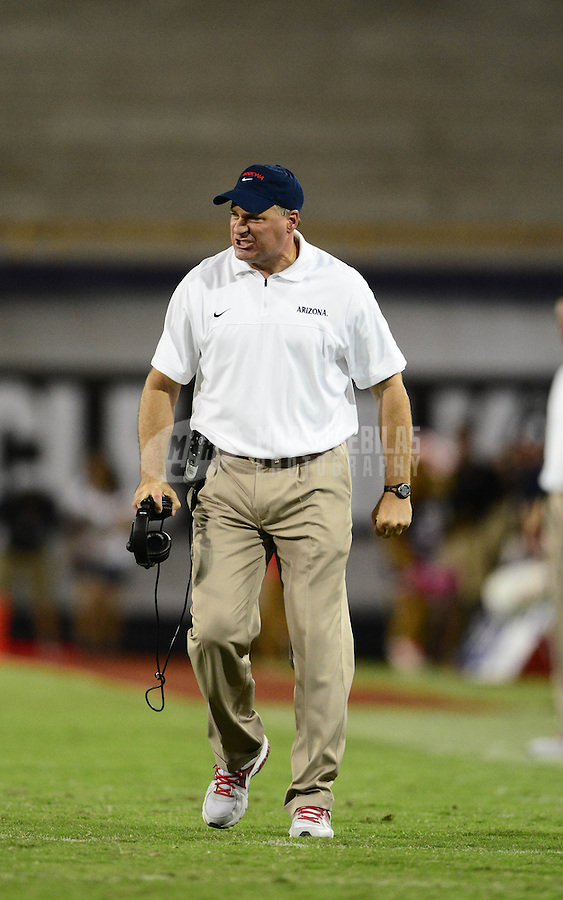 Oct. 20, 2012; Tempe, AZ, USA; Arizona Wildcats head coach Rich Rodriguez reacts on the sidelines in the second half against the Washington Huskies at Arizona Stadium. Arizona defeated Washington 52-17. Mandatory Credit: Mark J. Rebilas-