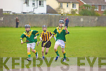 Kilmoyley player Kieran McCarthy  gets ready to score a goal while Eamon Dowling Kilmoyley and Daniel Murphy Abbeydorney look on. at the Feile na Gael blitz at Caherslee on Saturday.