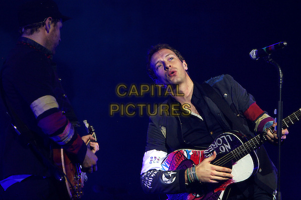 COLDPLAY - CHRIS MARTIN.Live at the 02 Arena, London, England..December 14th, 2008.stage concert gig performance music half length black jacket guitar singing .CAP/MAR.© Martin Harris/Capital Pictures.