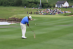 Graeme McDowell playing his second shot ont he 14th on the final day of the Celtic Manor Wales Open 2010.Picture Fran Caffrey/Newsfile.ie