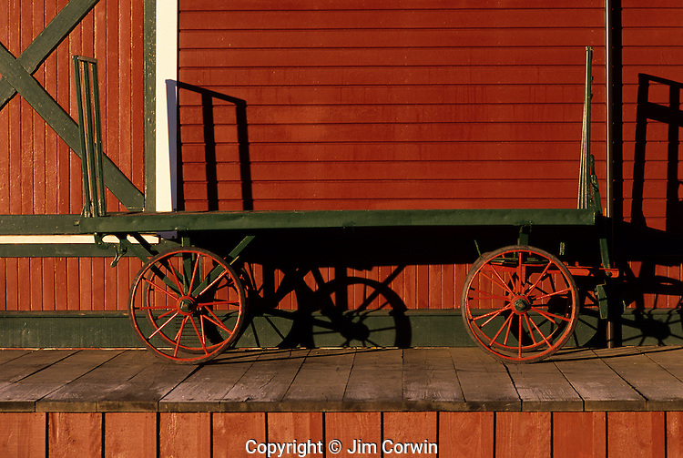 Historic train station with old time baggage cart sunrise Issaquah Washington State USA.