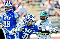 April 30, 2011:  Duke Blue Devils attack Jordan Wolf (31) controls the ball during lacrosse action between the Duke Blue Devils and Jacksonville Dolphins at D. B. Milne Field in Jacksonville, Florida.  Duke defeated Jacksonville 10-6.