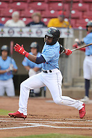 Cedar Rapids Kernels center fielder Akil Baddoo (24) swings at pitch against the South  Bend Cubs at Veterans Memorial Stadium on May 1, 2018 in Cedar Rapids, Iowa.  (Dennis Hubbard/Four Seam Images)
