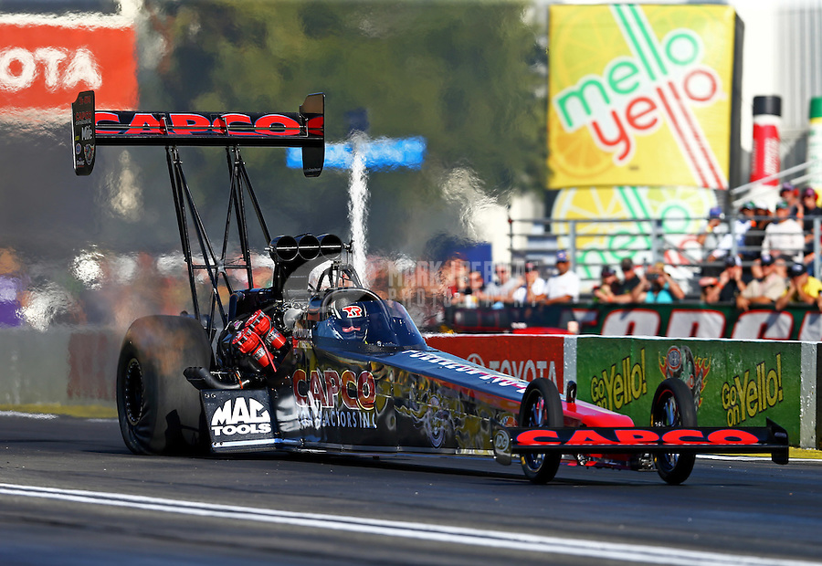 Nov 13, 2015; Pomona, CA, USA; NHRA top fuel driver Billy Torrence during qualifying for the Auto Club Finals at Auto Club Raceway at Pomona. Mandatory Credit: Mark J. Rebilas-USA TODAY Sports