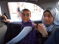 "Amira Al-Qerem (16, second from left) and her sister Haya are driven through Gaza City on October 28 2010. Amira was missing and presumed dead after she was injured by one of the same explosions that killed her father, brother and sister during the last days of the Israeli invasion of Gaza in 2009. She was found three days later, after her family thought they had buried her remains with those of the other three. She is one of the main subjects of the controversial documentary film ""Tears of Gaza"" by director Vibeke Løkkeberg."