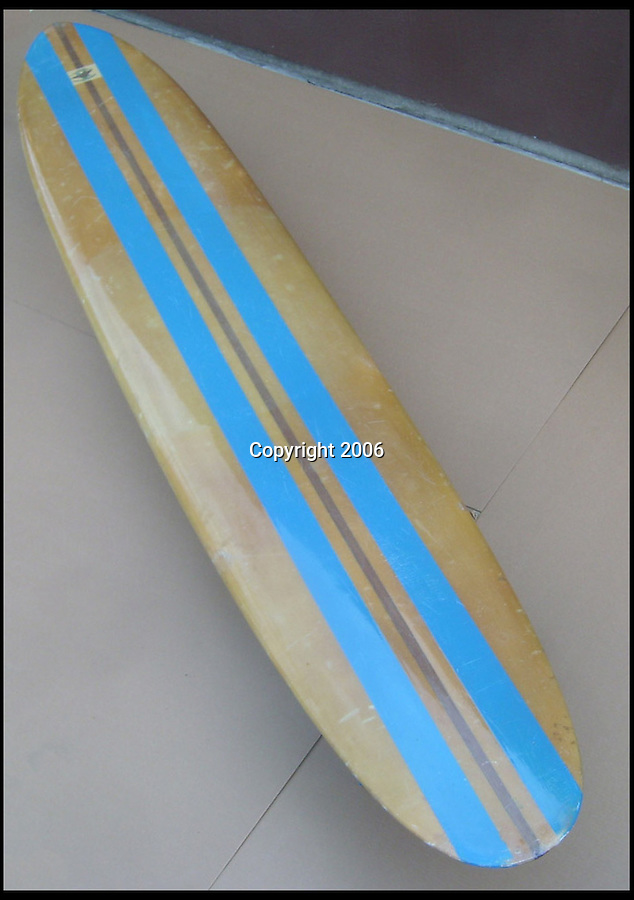 BNPS.co.uk (01202 558833)<br /> Pic: RockawayRecords/BNPS<br /> <br /> ****Please use full byline****<br /> <br /> The Topside.<br /> <br /> A surfboard belonging to legendary Beach Boys drummer Dennis Wilson which featured on the covers of two of their most famous albums has emerged for sale for £100,000.<br /> <br /> The iconic blue and yellow board was used for the cover of the Beach Boys' groundbreaking debut album, 1962's Surfin' Safari, and again in 1963 on the front of Surfer Girl.<br /> <br /> Wilson, the band's only surfer, brought the 9ft board along to the band's first ever professional photo shoot held on a beach in California in 1962 shortly after they signed with Capitol Records.<br /> <br /> The five members - Brian, Dennis and Carl Wilson, their cousin Mike Love and friend Al Jardine - were snapped holding it while striking various poses on a beach. The photos from the session went on to become some of the most iconic images of the band.<br /> <br /> Wilson gave the board to his close friend Louis Marotta in the 1970s who in turn passed it on to Beach Boys fan Bob Stafford in 1985.<br /> <br /> Mr Stafford is now selling the board with a whopping price tag of £100,000 after a short stint on display at the Grammy Museum in Los Angeles to mark the band's 50th anniversary.