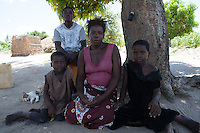 Rita Sebastiao is 9 years old, deaf-dumb since birth, and lives in Mutua, Sofala province, Mozambique together with her family. Handicap International supports Rita with school material and provided her access to an inclusive school. Rita together with her family in the backyard of their house.