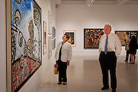 Before ribbon-cutting ceremony, Dr. Carol Damian, Curator for the Patricia and Phillip Frost Art Museum at Florida International University and Joel Kessler, Executive Director for the Naples Art Center at The von Liebig Art Center walk through the 'Cuba on My Mind' exhibit, featuring over 30 works of Cuban art, Naples, Florida, USA, March 10, 2011, Photo by Debi PIttman Wilkey.