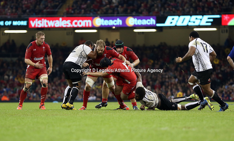 Pictured: Alun Wyn Jones of Wales (C) is brought down by Sunia Koto of Fiji. Saturday 15 November 2014<br />