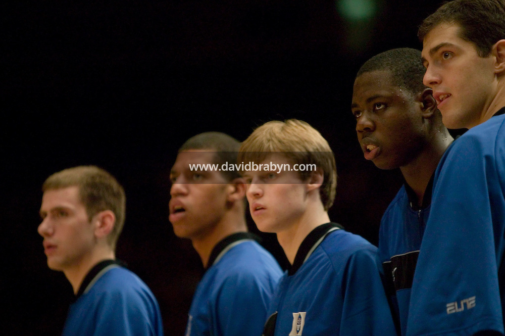 Eric Boateng (2R) watches his teammates from the Duke university bench during a pre-season college game at the Madison Square Garden in New York City, United States, 25 November 2005.
