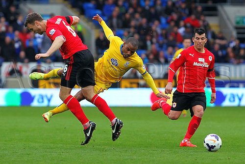 05.04.2014  Cardiff, Wales. Jason Puncheon of Crystal Palace is fouled by Ben Turner of Cardiff City during the Premier League game between Cardiff City and Crystal Palace  from Cardiff City Stadium.