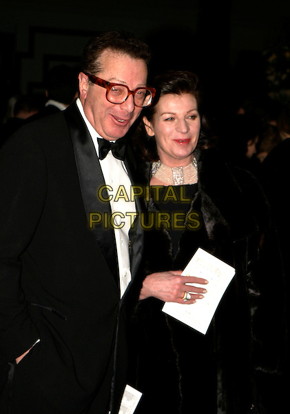 LORD SAATCHI & JOSEPHINE HART.Conservative Party Black & White Ball at Old Billingsgate Market, London, UK..February 8th, 2006.Ref: AH.half length glasses.www.capitalpictures.com.sales@capitalpictures.com.© Capital Pictures.