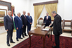Mr. Nabil Abu Rudeineh sworns in as Deputy Prime Minister and Minister of Information in the Government in front of Palestinian President Mahmoud Abbas, at his headquarters in the West bank city of Ramallah on Aug. 02, 2018. Photo by Thaer Ganaim
