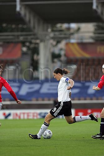 7th September 2009: 9 Birgit Prinz of Germany shoots. Germany beat Norway 3-1 in the Semi-Final match  of the UEFA Women's Euro 2009 at the Helsinki Football Stadium in Helsinki. Photo: Mark Hodsman/ActionPlus.