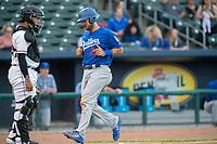 Tulsa Drillers catcher Steve Berman (22) crosses the plate for a run on May 13, 2019, at Arvest Ballpark in Springdale, Arkansas. (Jason Ivester/Four Seam Images)