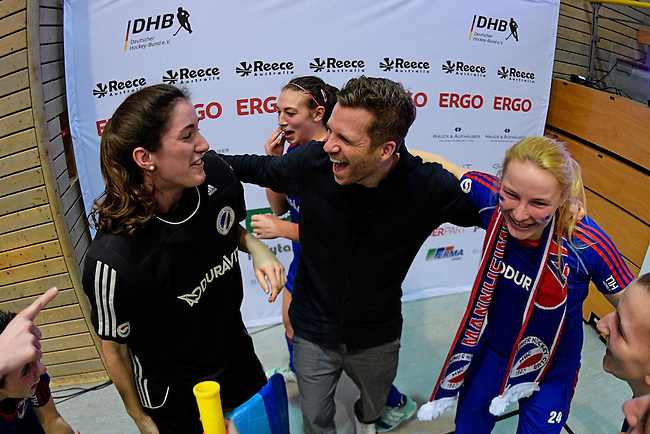GER - Luebeck, Germany, February 07: Players of Mannheimer HC celebrate after winning the shootout during the 1. Bundesliga Damen indoor hockey final match at the Final 4 between Mannheimer HC (blue) and Duesseldorfer HC (white) on February 7, 2016 at Hansehalle Luebeck in Luebeck, Germany. Final score 6-4 after shootout. (Photo by Dirk Markgraf / www.265-images.com) *** Local caption *** (c) head coach Philipp Stahr of Mannheimer HC