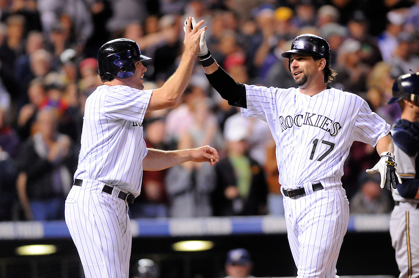 September 30, 2009: Rockies 1st baseman Todd Helton celebrates his 15th homerun of the year with outfielder Seth Smith in the 3rd inning during a regular season game between the Milwaukee Brewers and the Colorado Rockies at Coors Field in Denver, Colorado. The Rockies beat the Brewers 10-6, and lead the wild card race over Atlanta by 4 games, with 4 games to play. Helton's homerun was one of three Rockies homeruns in the game. *****For editorial use only*****